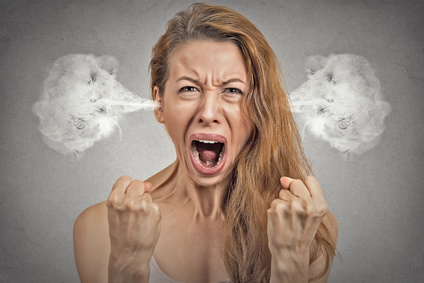 angry young woman blowing steam coming out of ears